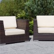 Outdoor furniture rattan armchairs on terrace garden - Stock Photo