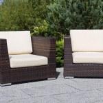 Outdoor furniture rattan armchairs on terrace garden — Stock Photo #13254270
