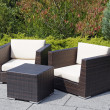 Outdoor furniture rattan armchairs and table - Stock Photo