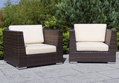 Outdoor furniture rattan armchairs on terrace garden — Stock Photo