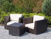 Outdoor furniture rattan armchairs and table — Zdjęcie stockowe