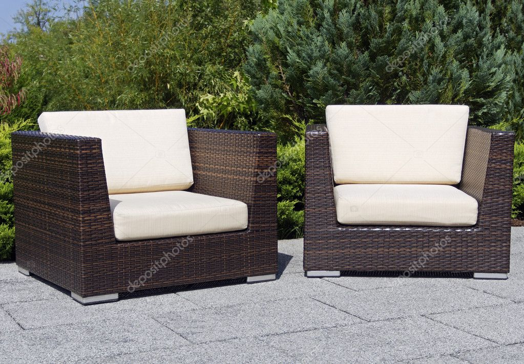 Outdoor furniture rattan armchairs on terrace garden — Stock Photo #13254270