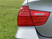 Red rear light of a silver car — Stock Photo