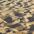 Fine sand texture with shallow depth of field — Stock Photo