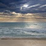 Dramatic sunrise or sunset over blue ocean — Stock Photo