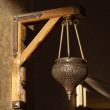 Arabic lamp with ornaments hanging on a wall — Stock Photo #16106679