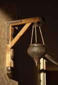 Arabic lamp with ornaments hanging on a wall — Stock Photo