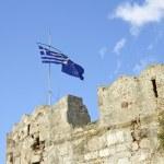 Greek national flag and eu flag against blue sky — Stock Photo #22457547