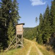 Deer stand hunting tower in forest — Stock Photo #25452897