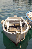 White fishing boat moored in a harbour — Stock Photo
