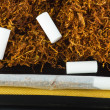 Tobacco and cigarette roller — Stock Photo #13147079