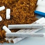 Tobacco and cigarette roller — Stock Photo #13147188