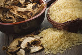 Rice and dried porcini mushrooms — 图库照片
