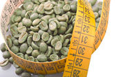 Drinking raw green coffee — Stock Photo