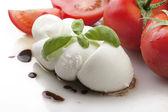 Mozzarella tomatoes and fresh salad — Stock Photo