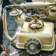 Old telephone with marble casing — Stock Photo