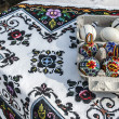 Painted eggs and tablecloth embroidered Romanian traditional — Stock Photo