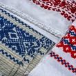 Materials and embroidered Romanian traditional port specific 2 - Stock Photo