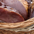 Stock Photo: Pork ham placed in wicker basket