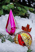 Winter decorations placed on a snowy tree — Stock Photo