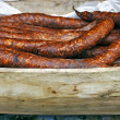 Stock Photo: Romanisausage in rustic wooden bowl carved