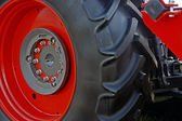 Large red wheel rim with rubber-2 — Stock Photo