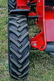 Front wheel of one tractor — Stock Photo