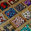 Colored beads in wooden box divided — Stock Photo #19196437