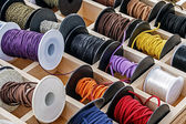 Spools with chains and colored ribbons 1 — Stock Photo