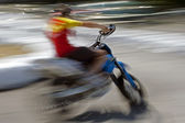 Abstract blurred motion motorcyclist 4 — Stock Photo