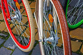 Multicolored bicycle wheels — Stock Photo