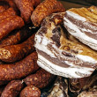 Stock Photo: Pieces of smoked pork bacon and sausages