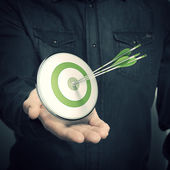Man Holding Green Target - Marketing Solutions Concept — Stock Photo