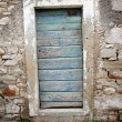 Blue door in old stone house — Stock Photo