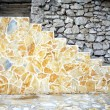 New stone stairs on old rocky background - Zdjęcie stockowe