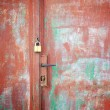 Padlock and handle on rusty door, detail — Stock Photo