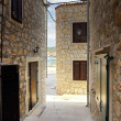 Narrow old street in stone, Croatia — Stock fotografie