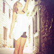 Beautiful girl stands on tiptoe, cross process — Stok Fotoğraf #13174301