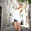 Happy beautiful woman dancing on the street — Stock Photo #13174420