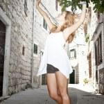 Happy beautiful woman dancing on the street — Stock Photo #13174420