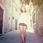 Happy beautiful woman dancing on the street — Stock Photo #13174440