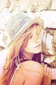 Portrait of beautiful woman in a straw hat — Стоковое фото