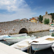 Old stone bridge and moored boats, CroatiDalmatia — стоковое фото #13359067