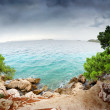 Royalty-Free Stock Photo: Stairs to the beach, clear water and cloudy sky in Croatia Dalmatia