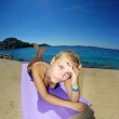 Young woman, sunbathing on a beach — Stock Photo