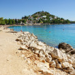 Rocky and concrete beach in the bay turquoise sea, Croatia Dalmatia — Stock Photo