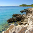 Stock Photo: Rocky coast of the turquoise sea, Croatia Dalmatia