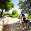 Senior cyclist riding along cost road by sea, Croatia — Stock Photo