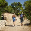 Tourists walking along the coast road by sea, Croatia Dalmatia — Stock Photo