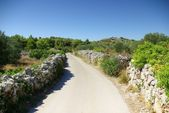 Narrow winding asphalt road between the rocks, Croatia Dalmatia — Stock Photo